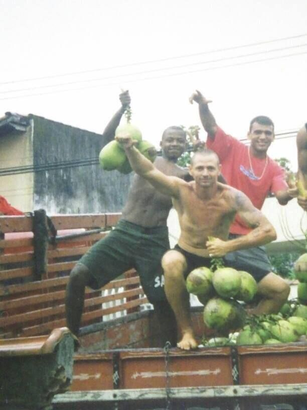 Leandro (red shirt) delivering coconuts in Ubatuba, Brazil.