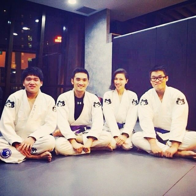 Soo Wei and her teammates take the time to smile for the camera after a BJJ class.