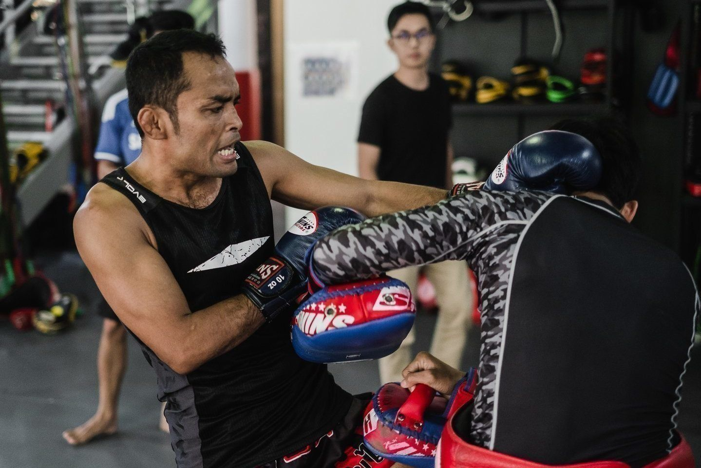 Dejdamrong throws a knee during a Muay Thai class at Evolve MMA in Singapore.
