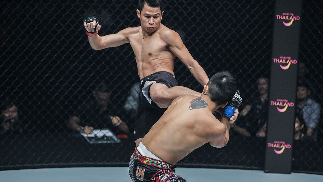 Sagetdao throws a Muay Thai kick during a ONE Championship MMA fight.