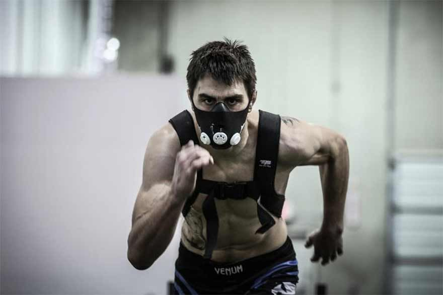 Former UFC Interim Welterweight World Champion Carlos Condit training with the elevation training mask.