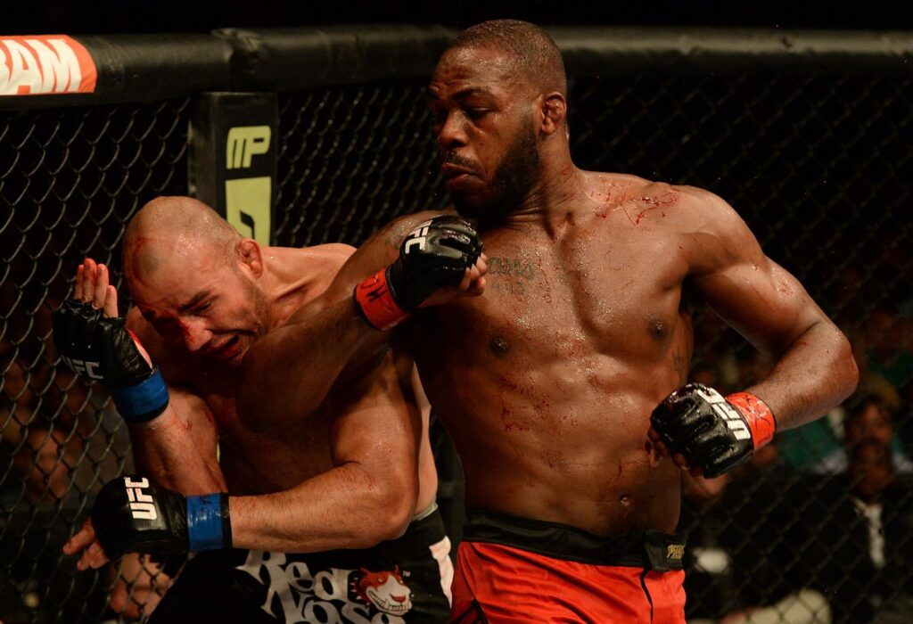 "BALTIMORE, MD - APRIL 26:  (R-L) Jon ""Bones"" Jones elbows Glover Teixeira in their light heavyweight championship bout during the UFC 172 event at the Baltimore Arena on April 26, 2014 in Baltimore, Maryland. (Photo by Patrick Smith/Zuffa LLC/Zuffa LLC via Getty Images)"