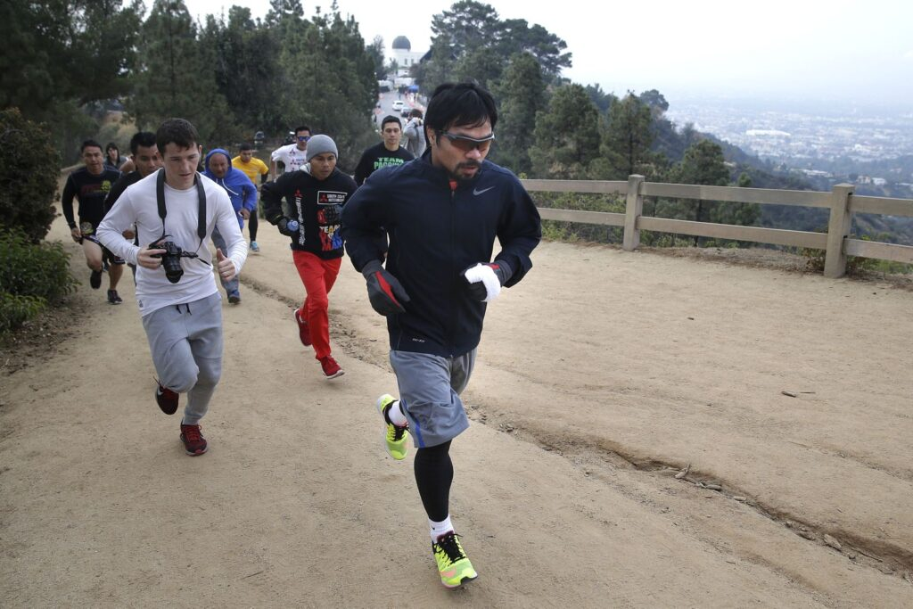 Boxer Manny Pacquiao, of the Philippines, runs along the trail at Griffith Park, Friday, April 10, 2015, in Los Angeles. Pacquiao is scheduled to fight Floyd Mayweather Jr. in a welterweight title fight in Las Vegas on May 2. (AP Photo/Jae C. Hong)