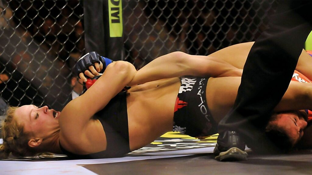 121613-UFC-ronda-rousey-attempts-to-submit-miesha-tate-ahn-PI