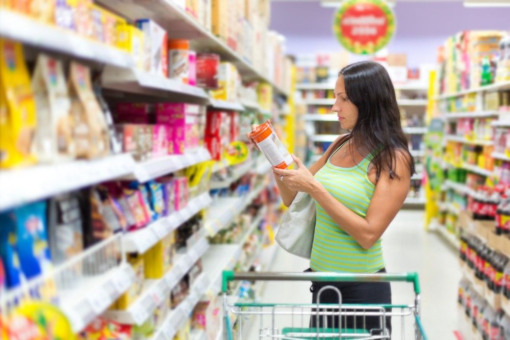 woman examining food label