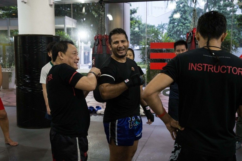 A Muay Thai student gets promoted to Level 2 by legendary Muay Thai instructor Daorung Sityodtong.