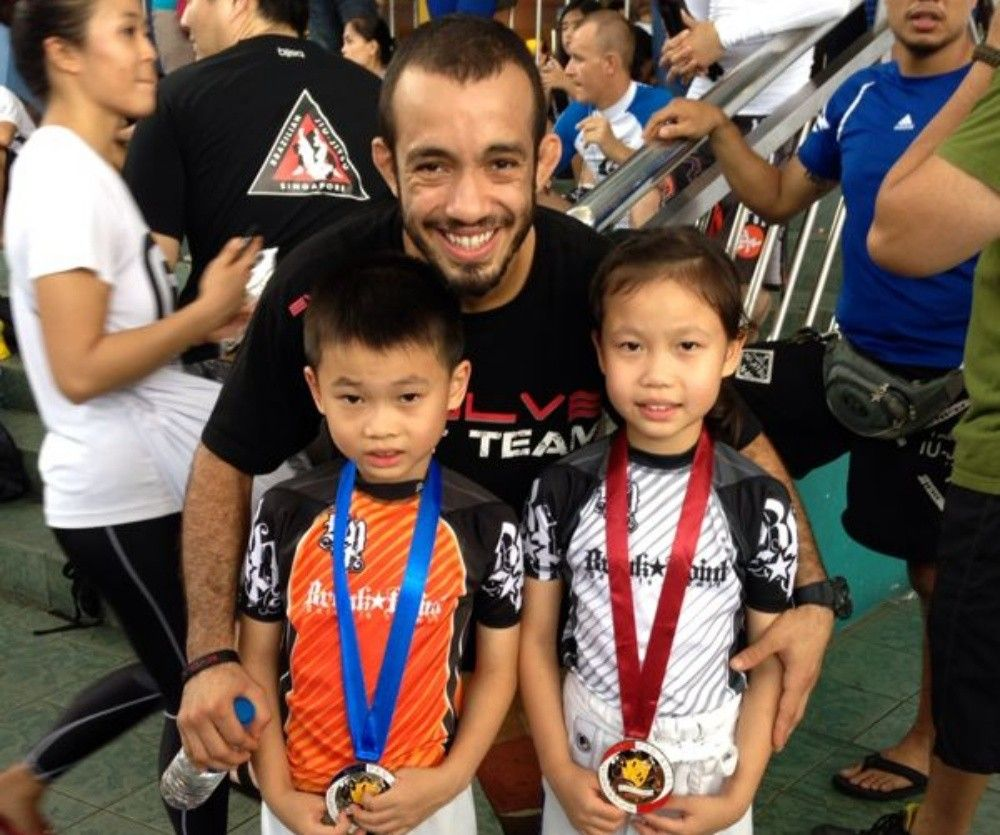 Cayden and Zea at the Pan Asian BJJ Competition in Manila with BJJ Champion and ONE Superstar Almiro Barros.
