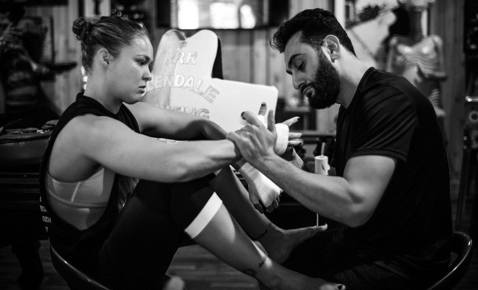Ronda Rousey gets her hands wrapped by her coach, Edmond Tarverdyan.