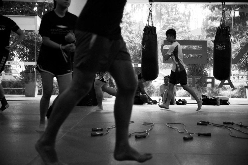 Muay Thai students warming up before a class.