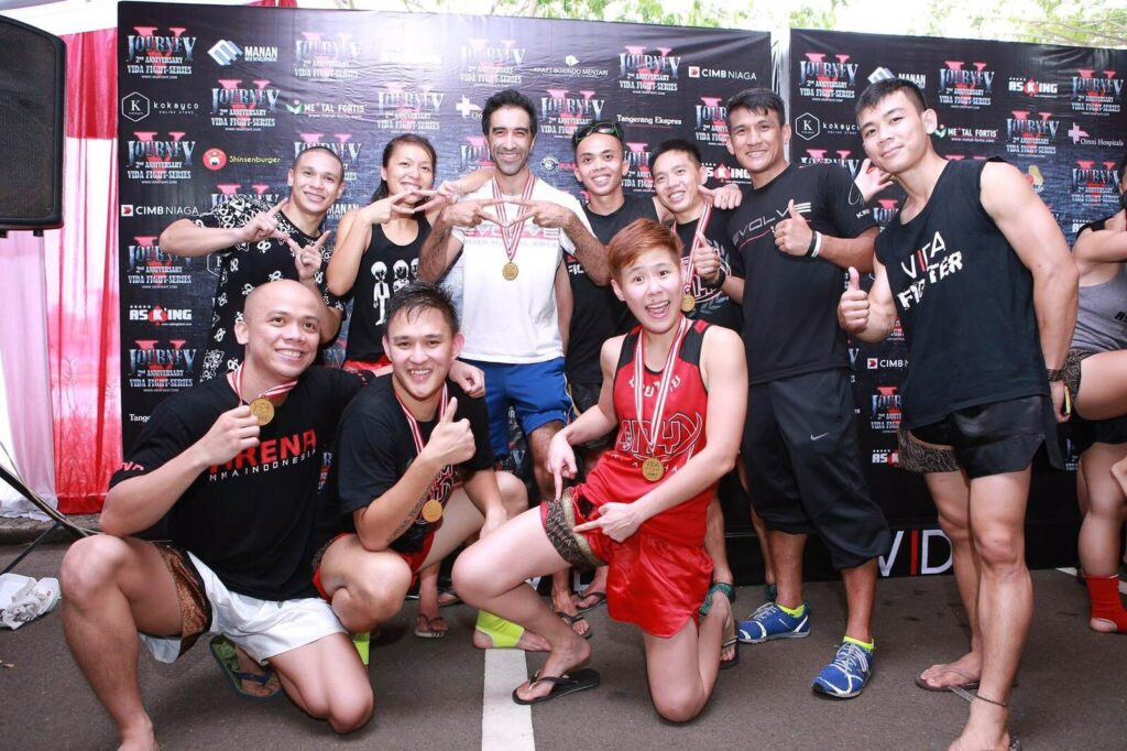 Irfan and his teammates from the Muay Thai competition team celebrate their victories.