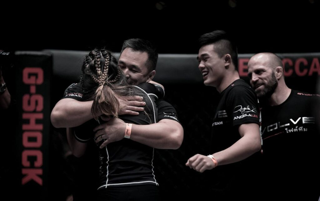 Angela hugs her dad after winning her last fight at ONE: Pride Of Lions.