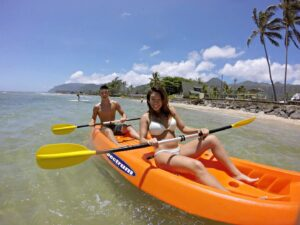 Angela and Christian enjoy a day at the beach in Oahu, Hawaii.