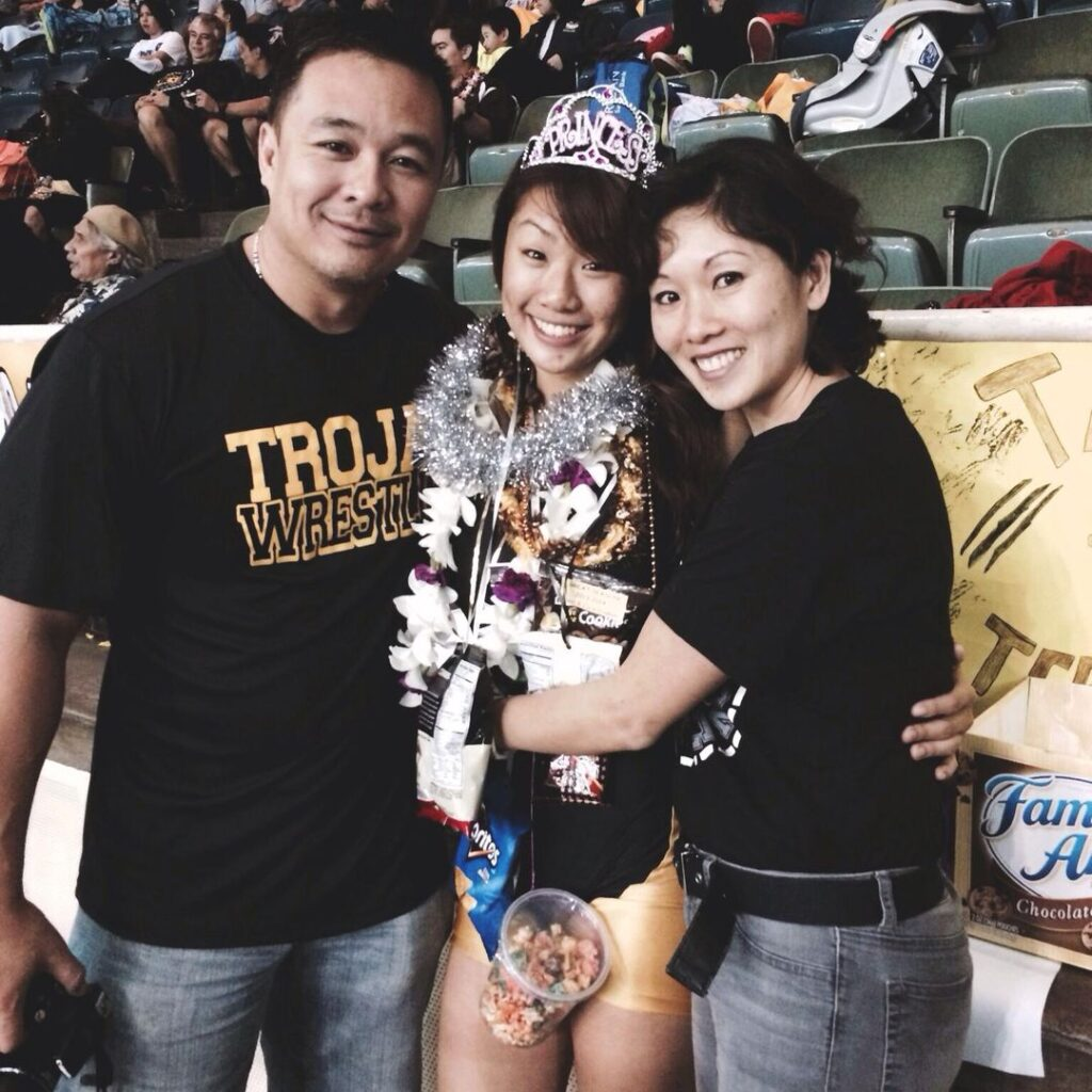 Angela wins the Hawaii state wrestling championship.