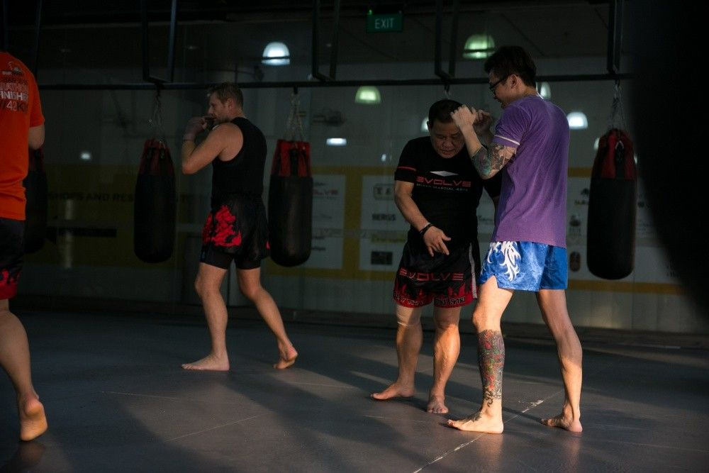 "Trainer of Muay Thai World Champions, ""Papa"" Daorung tries to improve his student's footwork."