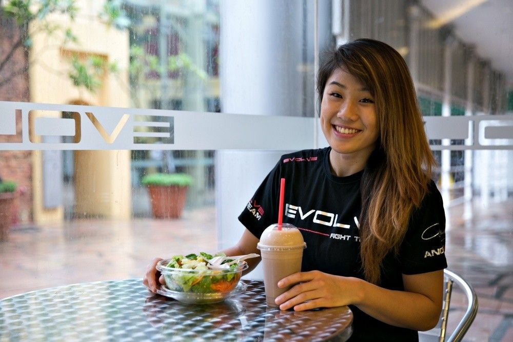 ONE Superstar Angela Lee enjoys her salad and smoothie after a hard day of training!