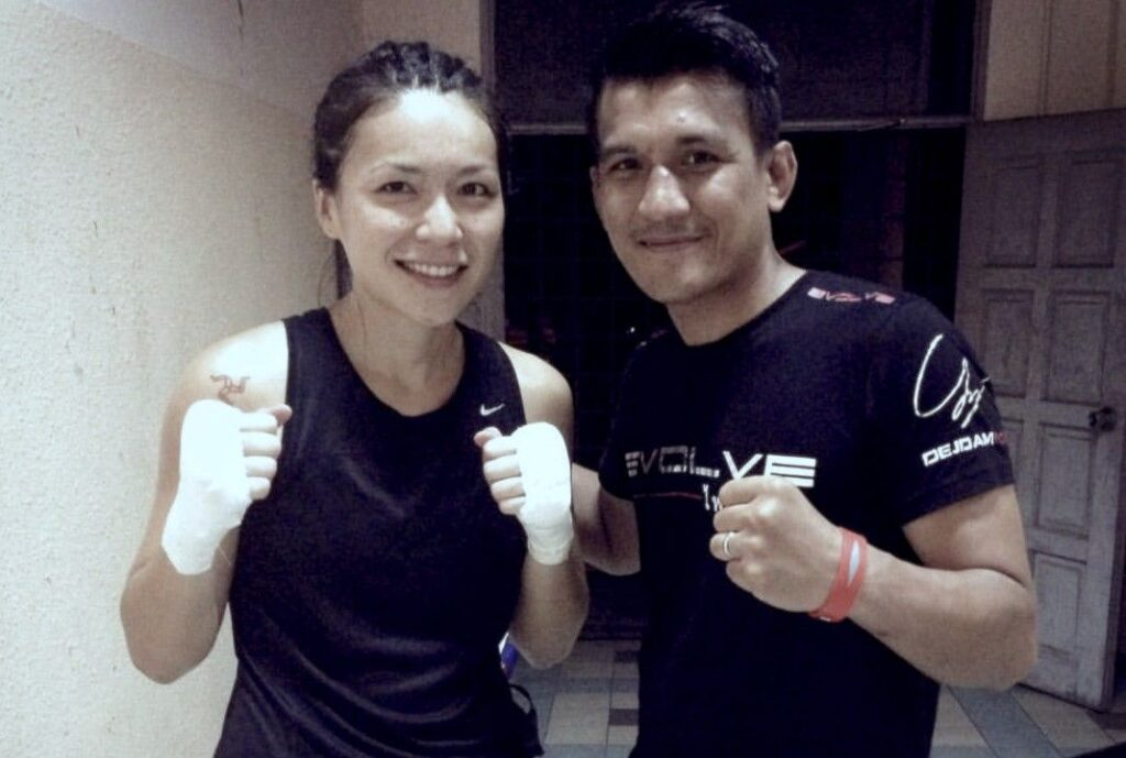 Multiple-time Muay Thai World Champion Namsaknoi Yudthagarngamtorn and his professional Muay Thai fighter girlfriend, Angie Wong.