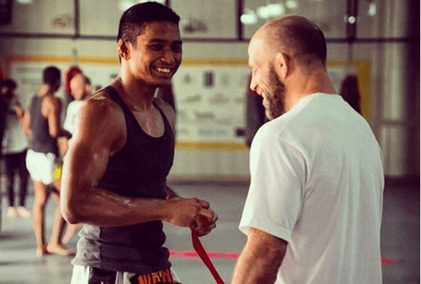 US Olympian and Evolve Fight Team Head Coach Heath Sims and ONE Superstar Amir Khan enjoy a funny moment after training.