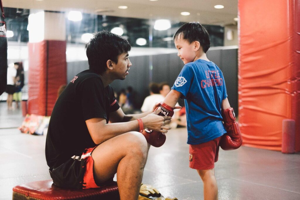 Multiple-time Muay Thai World Champion Penek Sitnumnoi teaches kids at Evolve MMA.