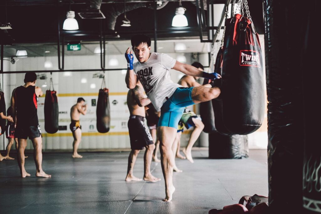 Training with a heavy bag builds strength and improves balance.