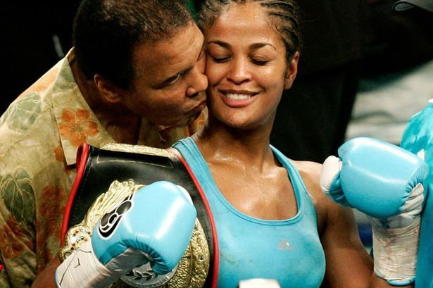 Muhammad and Laila Ali sharing a moment.