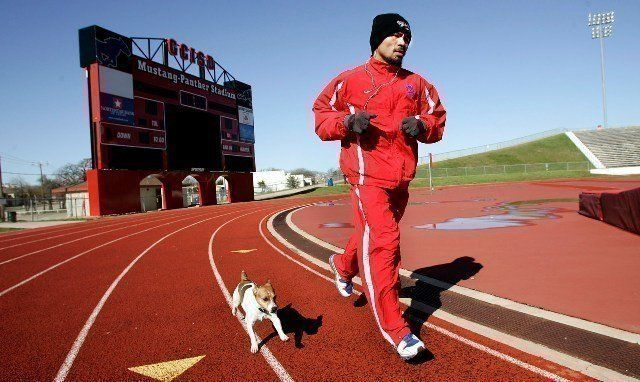 "3/9/10,Dallas,Texas --- ""DOUBLE PACMAN"" --- Seven-time world champion and ""Fighter of the Decade"" Manny ""Pacman"" Pacquiao takes a morning run with his dog 'Pacman' Tuesday morning for his upcoming World Welterweight championship against challenger Joshua Clottey on Saturday,March 13 at Cowboys Stadium in Arlington,Texas on HBO Pay-Per-View. --- Photo Credit : Chris Farina - Top Rank (no other credit allowed) copyright 2010"