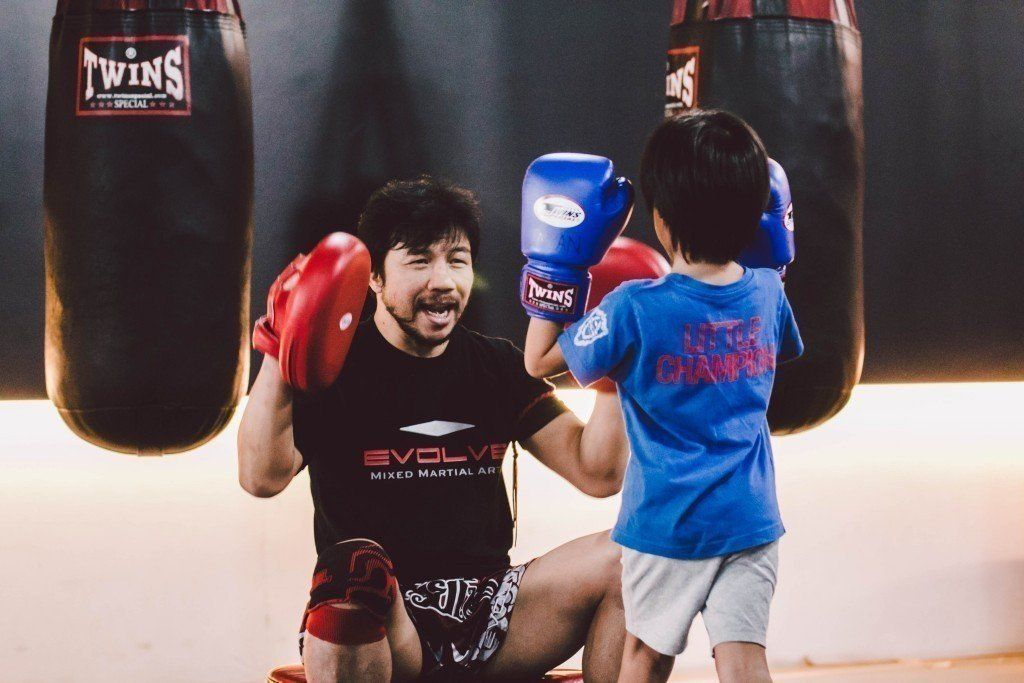 Multiple-time Muay Thai World Champion Muangfalek Kiatvichian teaches at Evolve MMA.