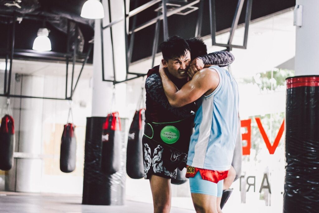 "Multiple-time Muay Thai World Champion Chaowalith Jockey Gym and ONE Superstar Eddie ""The Magician"" Ng work on their clinching at the Evolve MMA Fighters Program."