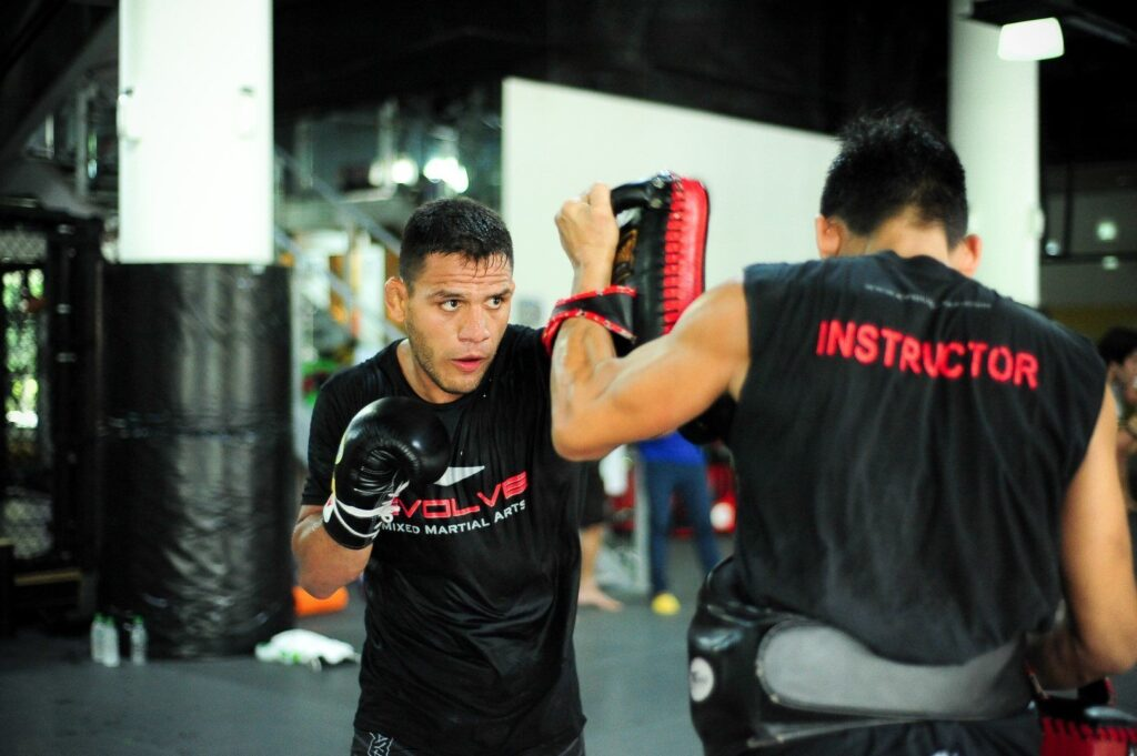 UFC Lightweight World Champion Rafael Dos Anjos sharpens his striking skills at Evolve MMA.