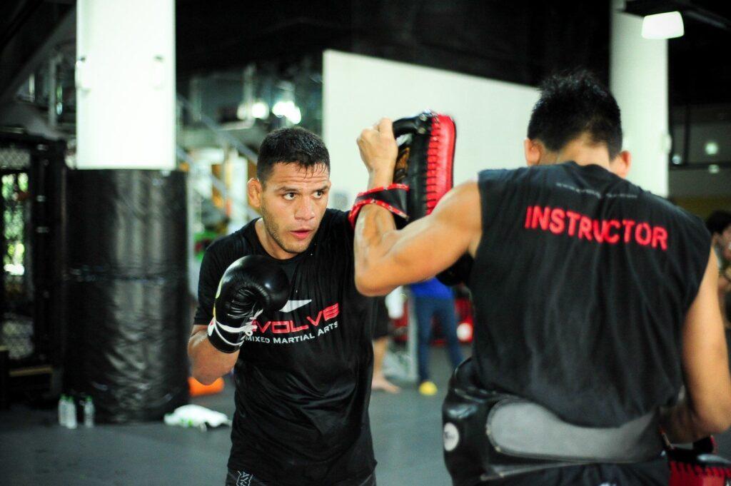 UFC Lightweight World Champion Rafael Dos Anjos sharpens his striking skills at Evolve MMA.