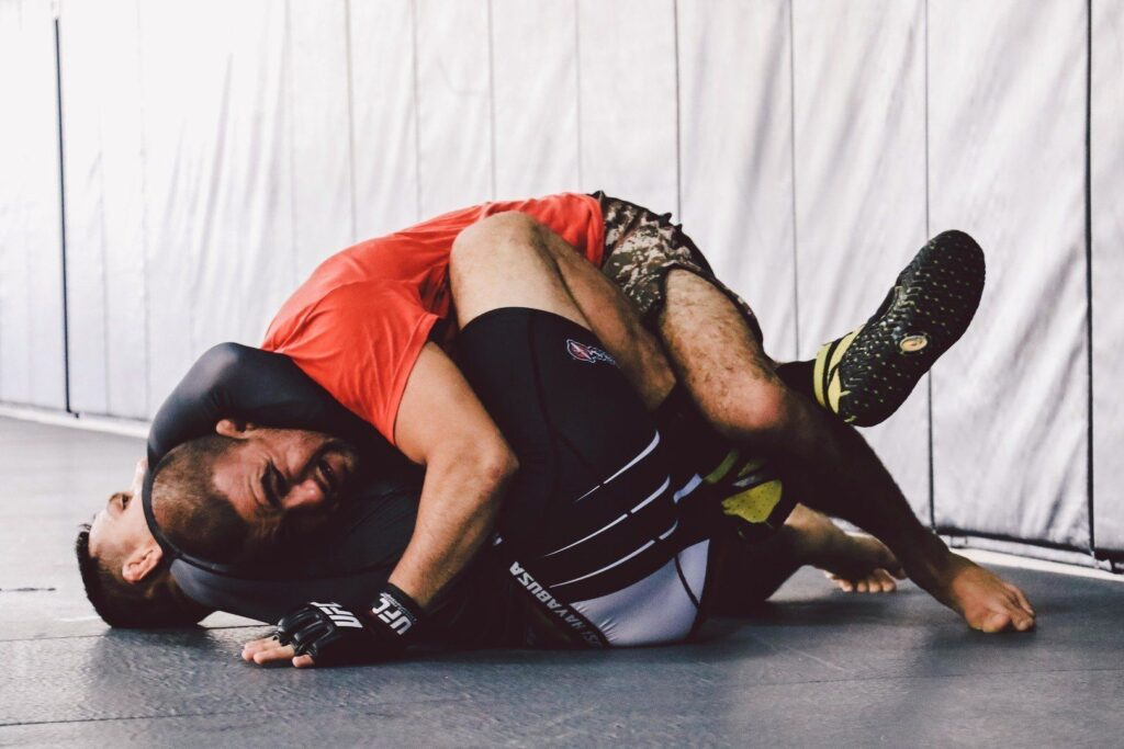 "BJJ World Champion and UFC Fighter Leandro ""Brodinho"" Issa works on escaping the guillotine."