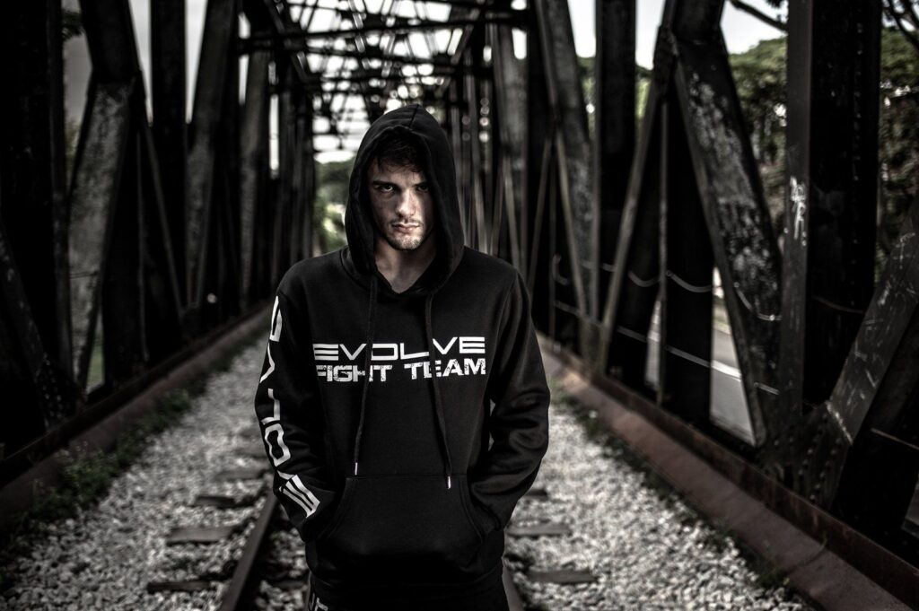 ONE Superstar Bruno Pucci is wearing the Evolve Fight Team hoodie.