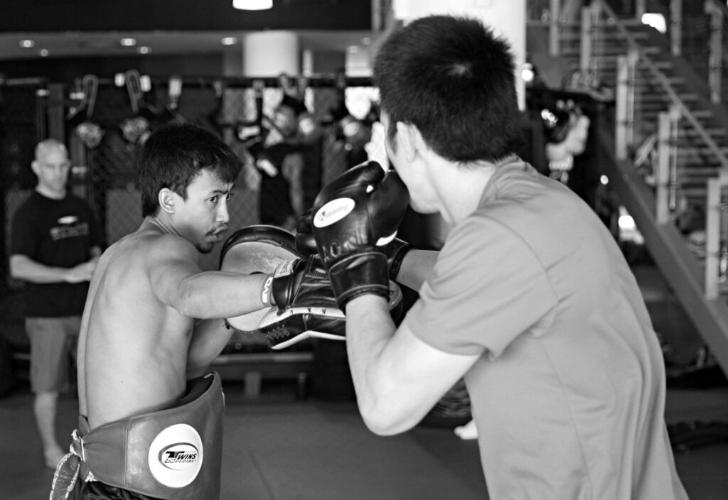 Multiple-time Muay Thai World Champion Penek Sitnumnoi helps ONE Lightweight World Champion Shinya Aoki with his striking.