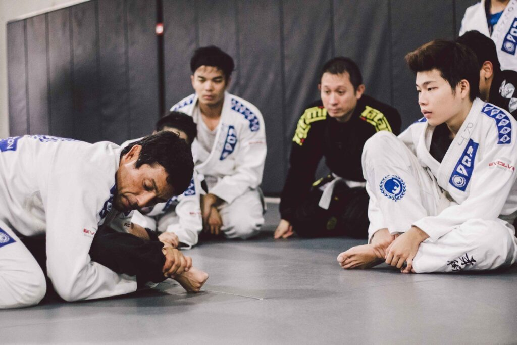 "2x BJJ World Champion Teco Shinzato shows his students how to perform an ""americana""."