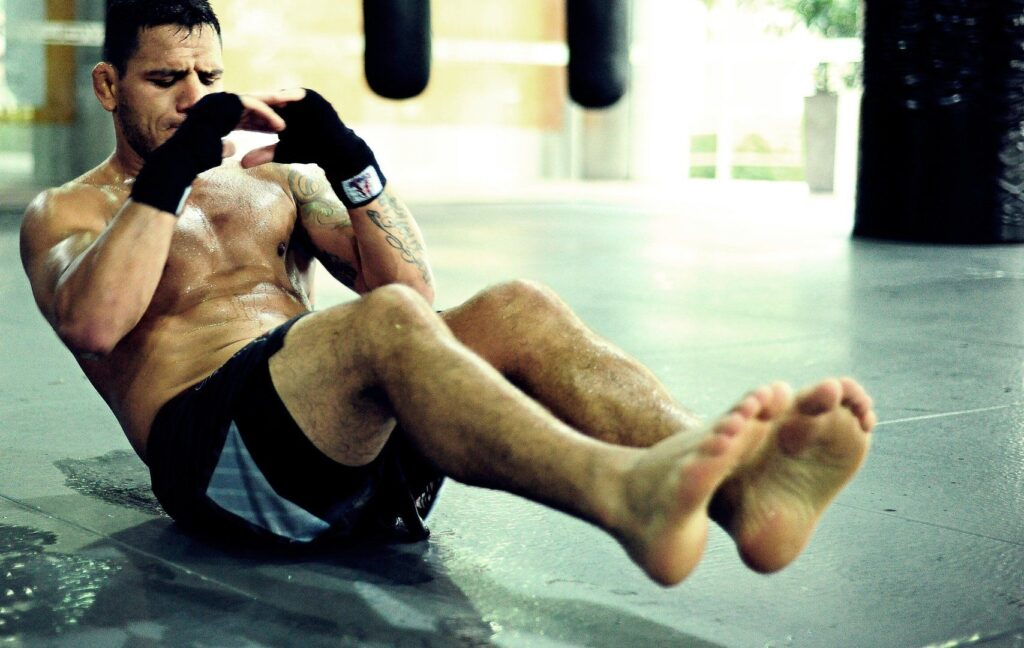 UFC Lightweight World Champion and BJJ World Champion Rafael Dos Anjos works on strengthening his core after a training session with the Evolve Fight Team.