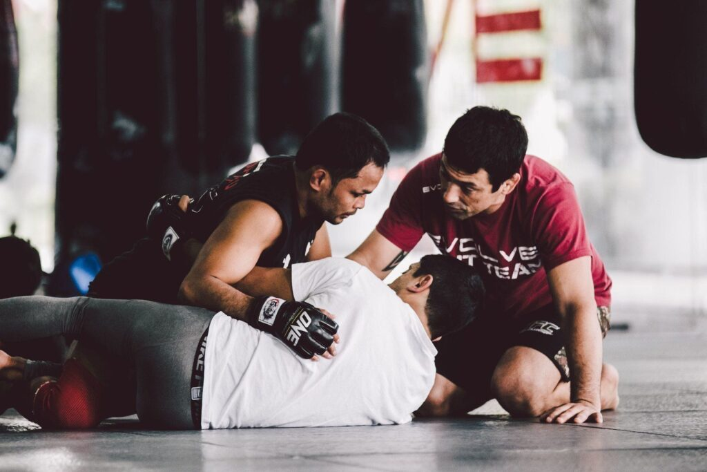 Multiple-time Muay Thai World Champion Dejdamrong Sor Amnuaysirichoke gets some grappling tips from BJJ World Champion Teco Shinzato.
