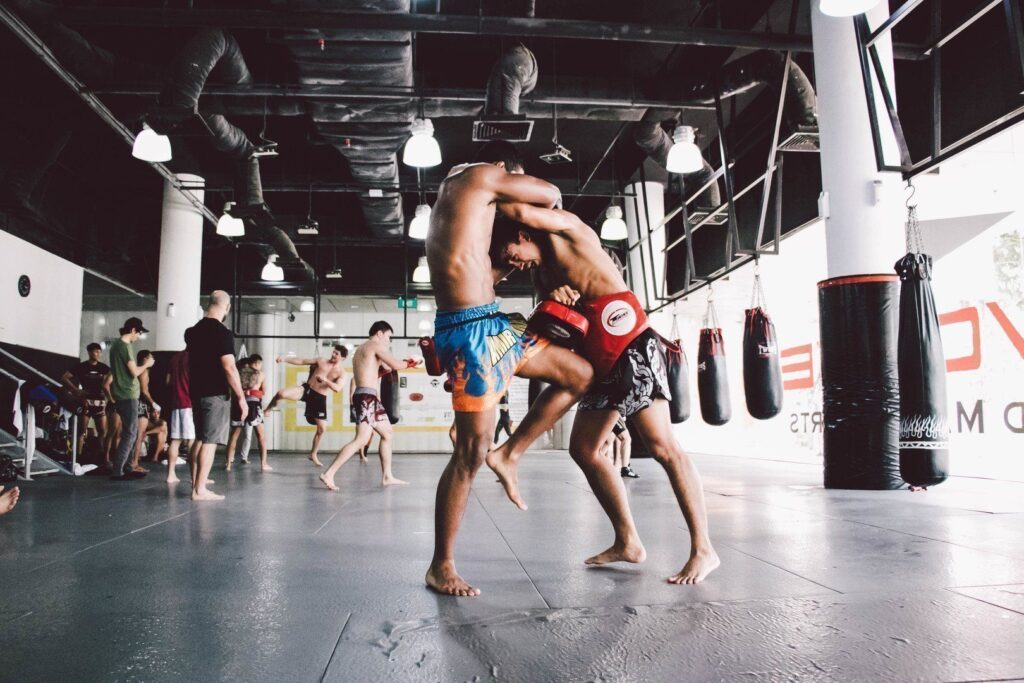 ONE Superstar Amir Khan practices his knees in the clinch with multiple-time Muay Thai World Champion Penek Sitnumnoi.