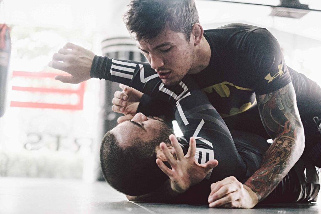 BJJ World Champion and ONE Superstar Bruno Pucci practices an arm triangle.