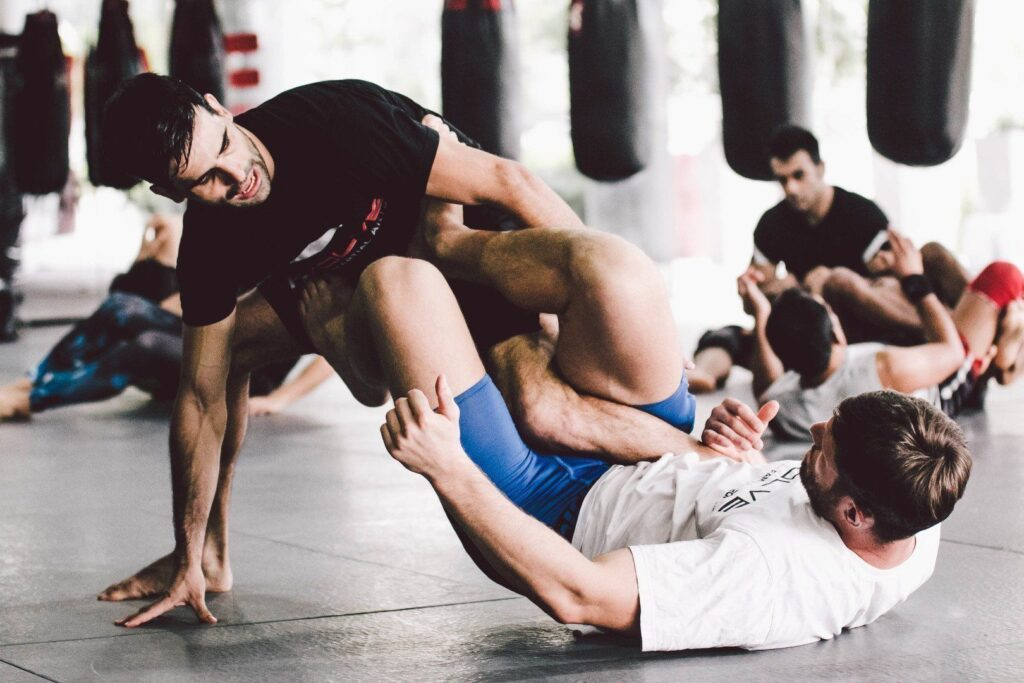 ONE Superstar Jake Butler and BJJ Nationals Champion Eduardo Novaes work on their submissions at the Evolve MMA Fighters Program.