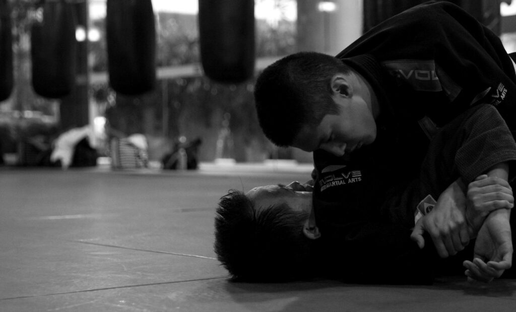 The americana lock is also known as the bent armlock, keylock, top wristlock, figure four armlock in catch wrestling, and ude garami in judo.