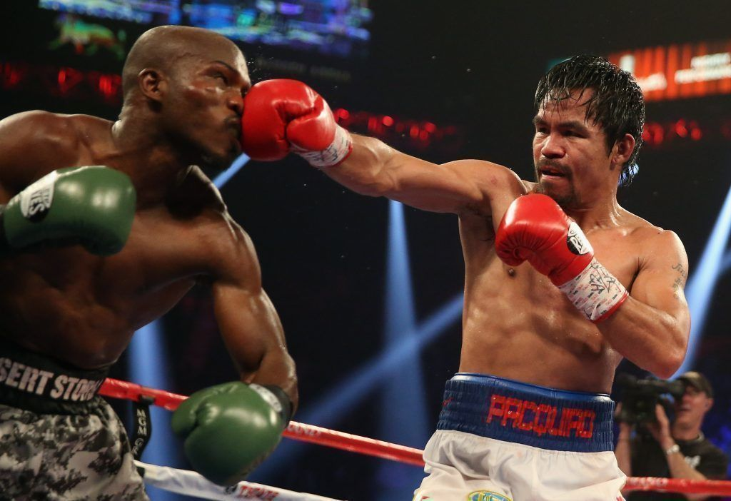 LAS VEGAS, NV - APRIL 12: Manny Pacquiao throws a right hand at Timothy Bradley at the MGM Grand Garden Arena on April 12, 2014 in Las Vegas, Nevada. (Photo by Jeff Gross/Getty Images)