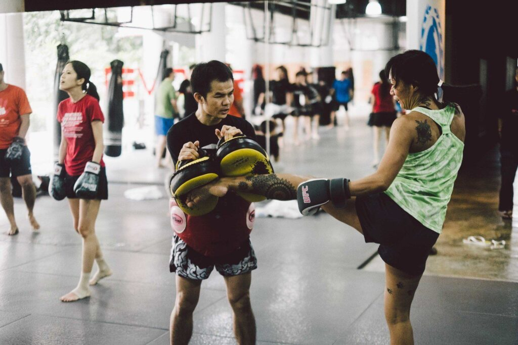 The roundhouse kick is one of the fundamental strikes in Muay Thai.