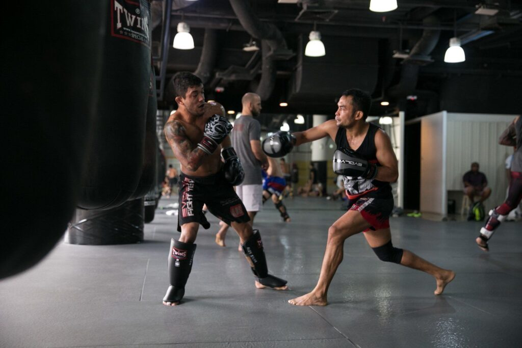 ONE Superstars Alex Silva and Dejdamrong Sor Amnuaysirichoke work on their striking at the Evolve Fighters Program.