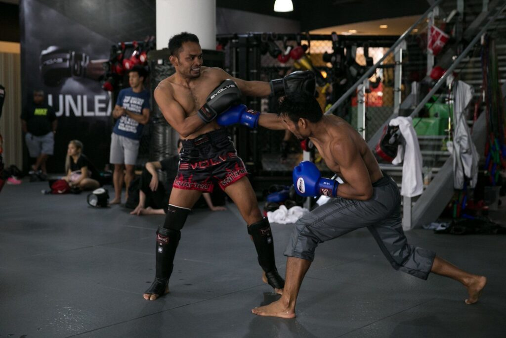 ONE Superstars Dejdamrong Sor Amnuaysirichoke and Yodsanan Sityodtong work on their striking at the Evolve Fighters Program.