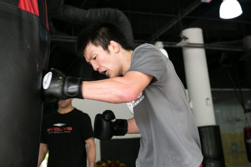 ONE Lightweight World Champion Shinya Aoki works on his striking at the Evolve Fighters Program.