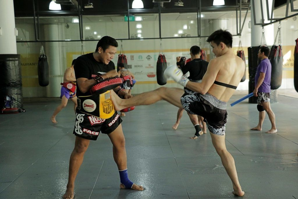 ONE Superstar Benedict Ang works on his striking at the Evolve Fighters Program.