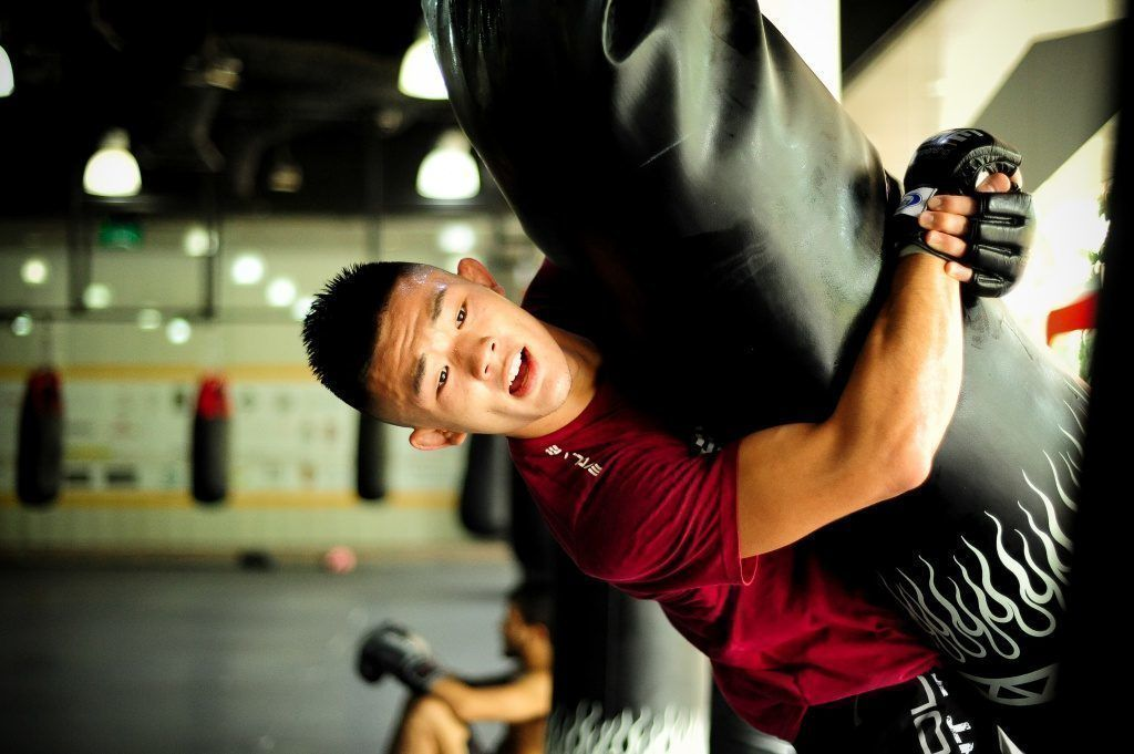 ONE Superstar Christian Lee works on his suplex at the Evolve MMA Fighters Program.