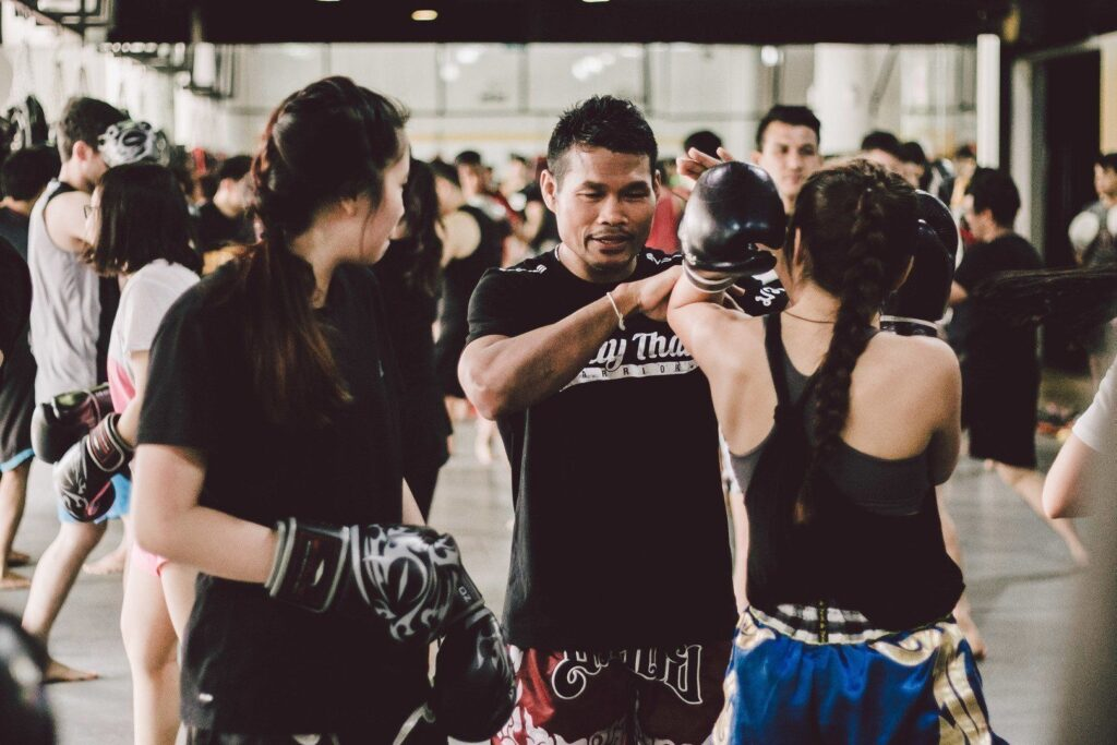 WBA Boxing World Champion Yodsanan Sityodtong breaks down a technique for his students.