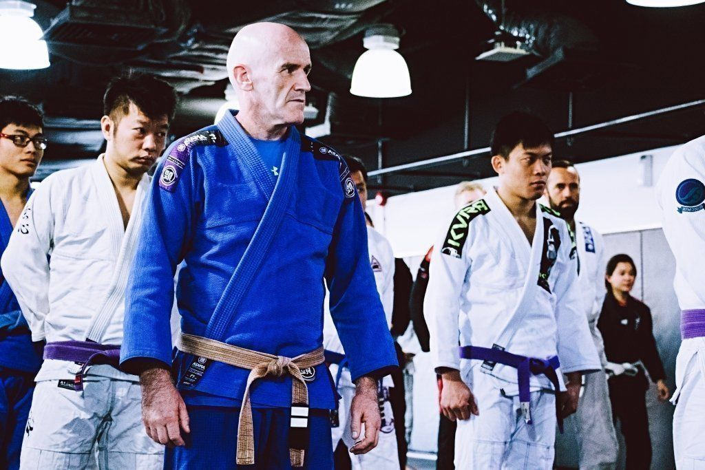 BJJ students standing in a line