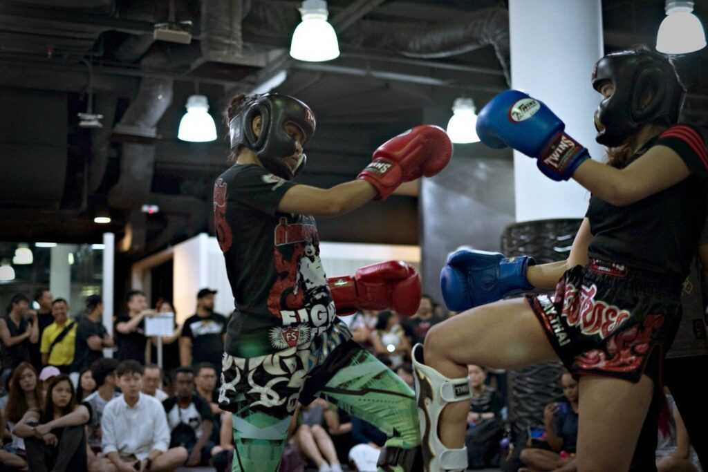 Two Muay Thai fighters fighting.
