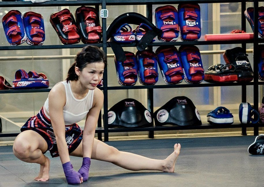 A student stretching before a Muay Thai class.
